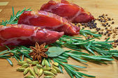 Sliced meat with rosemary — Stock Photo