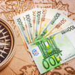 Stock Photo: Batch of Euro bills on map