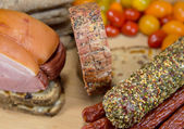 Meat assorted on wood table — Stock Photo