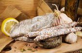 Meat assorted with cheese on wood — Stock Photo