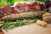 Assorted salami with herbs — Stock Photo