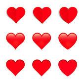 Rote Vektor-Herzen, isoliert auf weißem Hintergrund — Stockvektor
