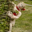 Rag doll in a wicker fence — Stockfoto