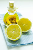 Lemon oil and sliced lemon — Stock Photo
