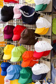 Colorful caps in a shop — Stock Photo