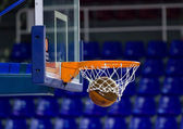Ball inside the basket net — Stock Photo