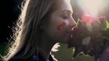 Women smelling on red roses — Stock Video
