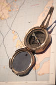 Antique map with compass — Stock Photo