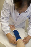 Foot Being Bandaged — Stock Photo