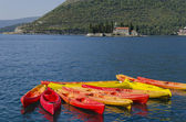 Colorful canoes in the sea golf — Stock Photo
