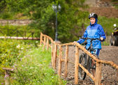 Cyclist girl rides — Stock Photo