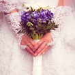 Bride is holding a bouquet — Stock Photo #43429841