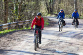 Friends riding bikes — Stock Photo