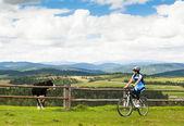 Girl cyclist — Stock Photo