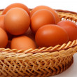 Colored eggs in straw basket — Photo #23664859