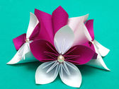 Paper flowers on a green background — Stock Photo