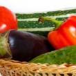 Tomato, pepper, cucumber, eggplant, squash in straw basket — Stockfoto