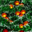 Christmas wreath of tinsel and balls as a texture — Stock Photo