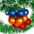 Christmas balls on a green tinsel as a symbol of the New year — Stock Photo