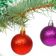 Red and violet balls on the Christmas tree — Stock Photo