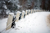 Stone fence in snow — Stock Photo