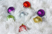 Christmas wreath of tinsel and colored balls as a texture — Stock Photo