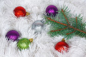 Christmas wreath of tinsel and colored balls with pine branch — Stock Photo