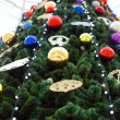 Christmas fir tree decorated with balls and garlands — Stock Photo #37787973