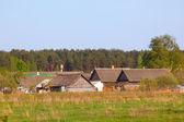 Village in spring rural landscape — Stock Photo