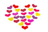 Many paper colored heart shapes — Stock Photo