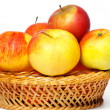 Stock Photo: Many apples in straw basket