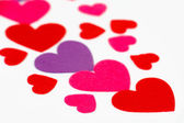 Many colored heart shapes in a row — Stock Photo