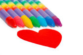 Red heart shape and colored chalks, crayons — Stock Photo