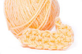 Skein of orange yarn closeup and crocheting knitting — Foto de Stock