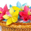 Stock Photo: Many colored paper flowers in basket