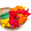 Stock Photo: Many colored paper tulips in basket