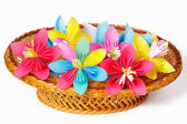 Many colored paper flowers in the basket — Stock Photo