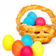 Baked basket with Easter colored eggs — Stock Photo #44651933