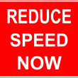 Stock Photo: Road work sign reduce speed now