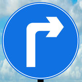 Turn right ahead traffic sign — Stock Photo