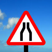 Warning triangle Road narrows on both sides — Stock Photo