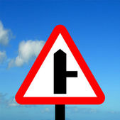 Warning triangle side road traffic sign — Stock Photo