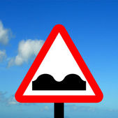 Warning triangle Uneven road — Stock Photo