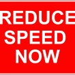 Reduce speed now sign — Stock Photo #24329583