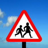 Warning triangle children crossing — Stock Photo
