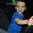 A young child driving a car — Stock Photo