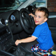 A young child driving a car — Photo