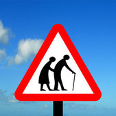 Frail pedestrians likely to cross road ahead — Stock Photo
