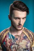 Stylish man with tattoos — Stock Photo