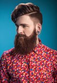 Stylish man with beard on blue background — Stock Photo